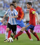 Followed by Spain's Gerard Pique, Argentina's Lionel Messi, left, dribbles past Spain's Xabi Alonso, right,  during a friendly soccer match in Buenos Aires, Argentina, Tuesday Sept. 7, 2010. (AP Photo/Jorge Araujo)