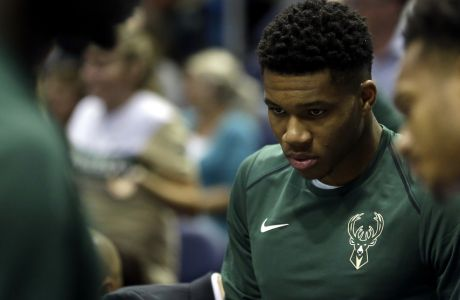 Milwaukee Bucks' Giannis Antetokounmpo is seen on the sidelines during a preseason NBA basketball game against the Indiana Pacers Wednesday, Oct. 4, 2017, in Milwaukee. (AP Photo/Aaron Gash)