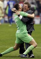 America's coach Miguel Herrera, right, and goalkeeper Agustin Marchesin celebrate after defeating Cruz Azul in the final Mexico soccer league championship match at Azteca stadium in Mexico City, Sunday, Dec. 16, 2018. (AP Photo/Eduardo Verdugo)