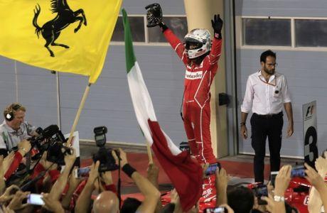 Ferrari driver Sebastian Vettel of Germany celebrates after winning the Bahrain Formula One Grand Prix, at the Formula One Bahrain International Circuit in Sakhir, Bahrain, Sunday, April 16, 2017. (AP Photo/Hassan Ammar)