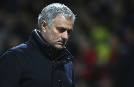 Manchester United head coach Jose Mourinho walks to the dressing room aft half time during the Champions League round of 16 second leg soccer match between Manchester United and Sevilla, at Old Trafford in Manchester, England, Tuesday, March 13, 2018. (AP Photo/Dave Thompson)