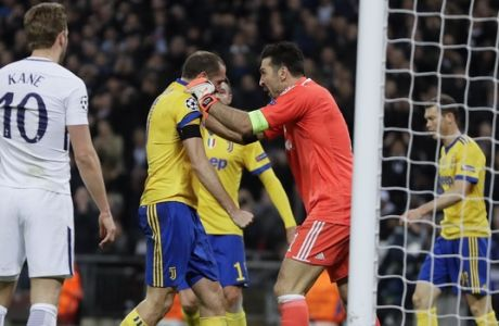 Juventus goalkeeper Gianluigi Buffon congratulates his teammate Giorgio Chiellini during the Champions League, round of 16, second-leg soccer match between Juventus and Tottenham Hotspur, at the Wembley Stadium in London, Wednesday, March 7, 2018. (AP Photo/Kirsty Wigglesworth)