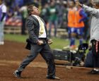 America's coach Miguel Herrera celebrates after defeating Cruz Azul at the final Mexico soccer league championship match at Azteca stadium in Mexico City, Sunday, Dec. 16, 2018. (AP Photo/Eduardo Verdugo)