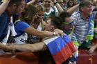 Slovenia's Luka Doncic celebrates with the supporters at the end of their Eurobasket European Basketball Championship semifinal match against Spain in Istanbul, Thursday, Sept. 14, 2017. Slovenia won 92-72. (AP Photo/Thanassis Stavrakis)