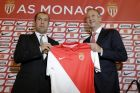 Monaco's new coach Leonardo Jardim of Portugal, left, poses with the AS Monaco team shirt with Vadim Vasilyev, vice President of AS Monaco, after a press conference in Monaco, Thursday, July 3, 2014. The 2014/2015 French football season begins on August 9. (AP Photo/Lionel Cironneau)