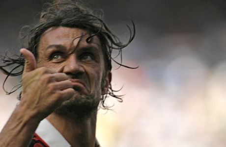 AC Milan defender Paolo Maldini salutes his fans at the end of the Italian Serie A soccer match between AC Milan and AS Roma at the San Siro stadium in Milan, Italy, Sunday, May 24, 2009. AC Milan captain 40 year-old Paolo Maldini played his last match at the San Siro stadium Sunday after 24 years and 901 games for the club.The match against AS Roma comes a week before the last game of the season away to Fiorentina and will bring to an end a career in which he has won seven Italian league titles, five Champions Leagues and 126 caps for Italy. (AP Photo/Alberto Pellaschiar)