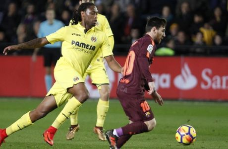 FILE - A Sunday, Dec. 10, 2017 file photo showing Villarreal's Ruben Semedo, left, challenging Barcelona's Lionel Messi, during the Spanish La Liga soccer match between Villarreal and FC Barcelona at the Ceramica stadium in Villarreal, Spain. Spanish club Villarreal says Tuesday Feb. 20, 2018 it has opened an investigation against defender Ruben Semedo after reports that he was arrested for an incident involving violence last week. (AP Photo/Alberto Saiz, File)