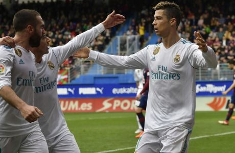 Real Madrid's Cristiano Ronaldo celebrates his second goal beside Lucas Vazquez and Daniel Carvajal after scoring during the Spanish La Liga soccer match between Real Madrid and SD Eibar at Ipurua stadium, in Eibar, northern Spain, Saturday, March 10, 2018. (AP Photo/Alvaro Barrientos)