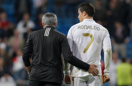 Real Madrid's coach Jose Mourinho from Portugal embraces Cristiano Ronaldo from Portugal after a Champions League round of 16, second leg soccer match against CSKA Moscow's at the Santiago Bernabeu Stadium, in Madrid, Wednesday, March 14, 2012. (AP Photo/Daniel Ochoa de Olza)