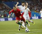 Portugal's Cristiano Ronaldo, left, is fouled by Spain's Nacho for a penalty during the group B match between Portugal and Spain at the 2018 soccer World Cup in the Fisht Stadium in Sochi, Russia, Friday, June 15, 2018. (AP Photo/Francisco Seco)