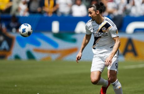 FILE - In this March 31, 2018, file photo, LA Galaxy's Zlatan Ibrahimovic, of Sweden, dribbles the ball during the second half of an MLS soccer match against Los Angeles FC in Carson, Calif. Ibrahimovic scored twice in an electrifying debut for the Galaxy last week despite jet lag and not being in top shape. A week later, the Swede plays his second MLS game, facing Sporting Kansas City on Sunday. (AP Photo/Jae C. Hong. File)