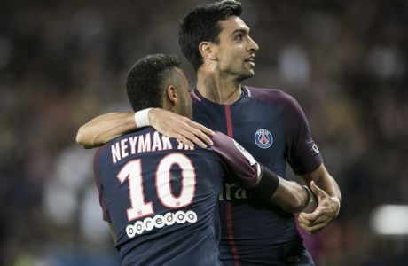 PSG's Javier Pastore, right, and PSG's Neymar celebrate after scoring against Toulouse during the French League One soccer match between PSG and Toulouse at the Parc des Princes stadium in Paris, France, Sunday, Aug. 20, 2017. (AP Photo/Kamil Zihnioglu)