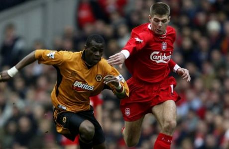 LIVERPOOL, ENGLAND - MARCH 20: Henri Camara of Wolverhampton Wanderers and Steven Gerrard of Liverpool in action during the FA Barclaycard Premiership match between Liverpool and Wolverhampton Wanderers at Anfield on March 20, 2004 in Liverpool, England.  (Photo by Gary M.Prior/Getty Images)