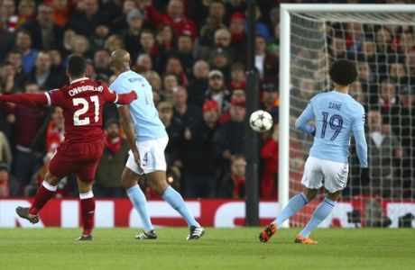 Liverpool's Alex Oxlade-Chamberlain, left, scores his side's second goal during the Champions League quarter final first leg soccer match between Liverpool and Manchester City at Anfield stadium in Liverpool, England, Wednesday, April 4, 2018. (AP Photo/Dave Thompson)