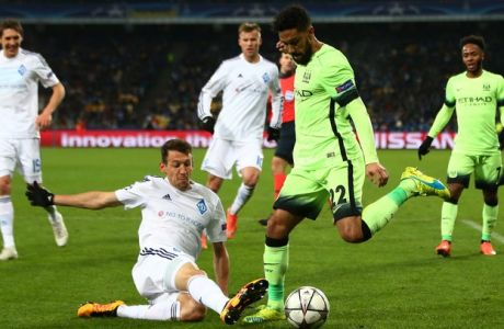 KIEV, UKRAINE - FEBRUARY 24:  Gael Clichy of Manchester City is tackled by Danilo Silva of Dynamo Kiev during the UEFA Champions League round of 16, first leg match between FC Dynamo Kyiv and Manchester City FC at the Olympic Stadium on February 24, 2016 in Kiev, Ukraine.  (Photo by Michael Steele/Getty Images)