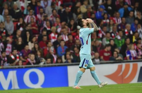 FC Barcelona's Lionel Messi laments after missing a goal during the Spanish La Liga soccer match between Athletic Bilbao and FC Barcelona, at San Mames stadium, in Bilbao, northern Spain, Saturday, Oct. 28, 2017. (AP Photo/Alvaro Barrientos)