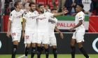 Sevilla's players celebrates after scoring their side's first goal scored by Franco Vazquez, 2nd left, during the Europa League group A soccer match between Sevilla and Dudelange at the Estadio Ramon Sanchez-Pizjuan stadium in Seville, Spain, Thursday, Oct. 24, 2019. (AP Photo/Miguel Morenatti)
