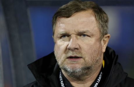 Plzen coach Pavel Vrba looks out from the bench prior the Europa League round of 32 second leg soccer match between Dinamo Zagreb and Viktoria Plzen at Maksimir Stadium in Zagreb, Croatia, Thursday, Feb. 21, 2019. (AP Photo/Darko Bandic)