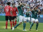 Germany's Mario Gomez, center, and Germany's Mats Hummels, right, hold their heads after failing to score during the group F match between South Korea and Germany, at the 2018 soccer World Cup in the Kazan Arena in Kazan, Russia, Wednesday, June 27, 2018. (AP Photo/Lee Jin-man)