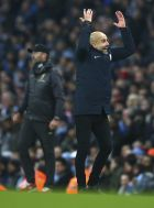 Manchester City's coach Pep Guardiola reacts during the English Premier League soccer match between Manchester City and Liverpool at the Etihad Stadium in Manchester, England, Thursday, Jan. 3, 2019.(AP Photo/Dave Thompson)