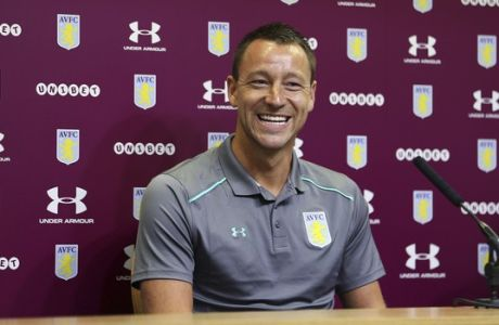 """New Aston Villa signing John Terry, reacts during the media conference at Villa Park, Birmingham, England, Monday July 3, 2017.  Former England and Chelsea captain John Terry has signed a one-year deal with second-division Aston Villa, saying he is """"delighted"""" and is looking to """"help the squad achieve something special this season.""""(Aaron Chown/PA via AP)"""
