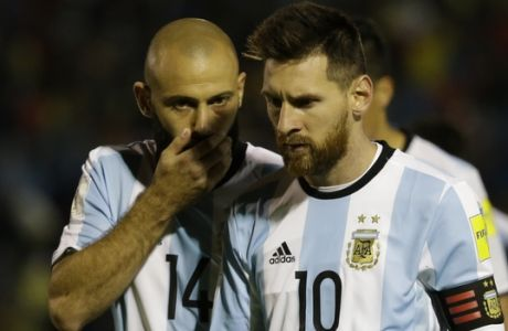 Argentina's Javier Mascherano, left, talks with Argentina's Lionel Messi as they leave the pitch on halftime during their 2018 World Cup qualifying soccer match against Ecuador at the Atahualpa Olympic Stadium in Quito, Ecuador, Tuesday, Oct. 10, 2017. (AP Photo/Fernando Vergara)