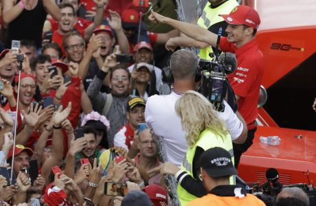 Ferrari driver Charles Leclerc of Monaco celebrates after winning the Formula One Italy Grand Prix at the Monza racetrack, in Monza, Italy, Sunday, Sept.8, 2019. (AP Photo/Luca Bruno)