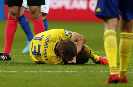 Sweden's Jakob Johansson lies on the pitch in pain during the World Cup qualifying play-off second leg soccer match between Italy and Sweden, at the Milan San Siro stadium, Italy, Monday, Nov. 13, 2017. (AP Photo/Antonio Calanni)