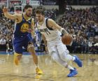 Golden State Warriors guard Klay Thompson (11) defends as Dallas Mavericks guard Luka Doncic (77) drives past in the second half of an NBA basketball game Sunday, Jan. 13, 2019, in Dallas. The Warriors won, 119-114. (AP Photo/Richard W. Rodriguez)