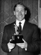 "Bert Trautmann, German-born goalkeeping star of FA Cup finalist Manchester City, holds his trophy award as ""Footballer of the Year"" at the May 3, 1956 dinner at ""Criterion"", Piccadilly in London, United Kingdom. Trautmann is the first foreign player to win the title. The title is from a ballot by the English Football Writers' Association, and presented at their annual dinner. (AP Photo/Robert Dear)"