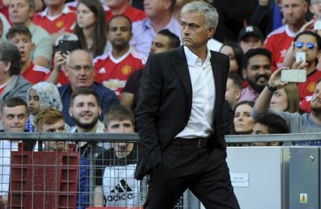 Manchester United manager Jose Mourinho walks off the pitch at halftime of the English Premier League soccer match between Manchester United and Leicester City at Old Trafford in Manchester, England, Saturday, Aug. 26, 2017. (AP Photo/Rui Vieira)