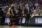 Toronto Raptors' head coach Nick Nurse, right, listens to Serge Ibaka, center, during the first half of Game 3 of a second-round NBA basketball playoff series against the Philadelphia 76ers, Thursday, May 2, 2019, in Philadelphia. 76ers won 116-95. (AP Photo/Chris Szagola)