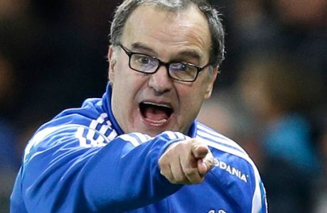 FILE - In this file photo dated Friday, Jan. 23, 2015 Coach of Marseille, Marcelo Bielsa reacts during the French League One soccer match Nice vs Marseille, Friday, Jan. 23, 2015, in Nice stadium, southeastern France.  In the latest controversy in his coaching career, Marcelo Bielsa quit as coach of Lazio on Friday, July 8, 2016, just two days after the Italian club announced it signed the former Argentina manager. (AP Photo/Lionel Cironneau, FILE)