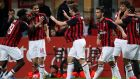 AC Milan's Fabio Borini, center, celebrates with teammates after scoring their team's second goal during the Italian Serie A soccer match between AC Milan and Bologna at the San Siro stadium, in Milan, Italy, Monday, May 6, 2019. (AP Photo/Antonio Calanni)
