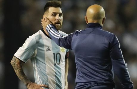 Argentina's Lionel Messi, left, is comforted by Argentina coach Jorge Sampaoli after a World Cup qualifying soccer match at La Bombonera stadium in Buenos Aires, Argentina, Thursday, Oct. 5, 2017. Argentina tied the match 0-0 and is almost eliminated from the upcoming World Cup in Russia. (AP Photo/Victor R. Caivano)