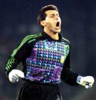 Argentina's goalkeeper Sergio Javier Goycochea, runs cheering to celebrate with his team mates after saving the penalty kicked by Italy's Aldo Serena at the end of extra time in the World Cup Soccer semi-final, in Naples, Italy, July 3, 1990. This was the second missed penalty by Italy. Argentina won by scoring 4 penalties. (AP Photo)
