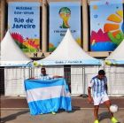 RIO DE JANEIRO, BRAZIL - JUNE 11:  Argentina fans juggle a soccer ball in front of Maracana stadium as the 2014 FIFA World Cup nears on June 11, 2014 in Rio de Janeiro, Brazil.  (Photo by Jamie Squire/Getty Images)