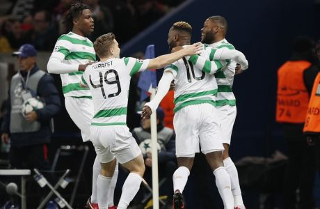 Celtic's Moussa Dembele, second right back to camera, celebrates with teammates after scoring his side's opening goal during a Champions League Group B soccer match between Paris St. Germain and Celtic at the Parc des Princes stadium in Paris, France, Wednesday, Nov. 22, 2017. (AP Photo/Christophe Ena)