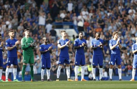 Chelsea players applaud in memory of Roy Bentley who was the leading scorer for the 1955 Chelsea team that won the league, who died last month, prior to the English Premier League soccer match between Chelsea and Liverpool at Stamford Bridge stadium in London, Sunday, May 6, 2018. (AP Photo/Frank Augstein)