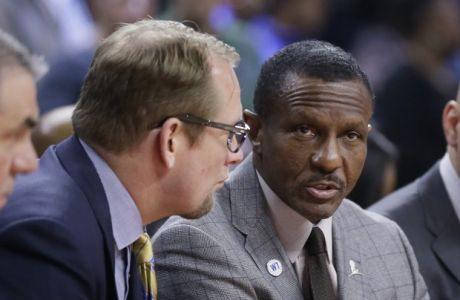 From left, Toronto Raptors assistant coaches Andy Greer, Nick Nurse, head coach Dwane Casey and assistant Rex Kalamian are seen on the bench during the first half of an NBA basketball game against the Detroit Pistons, Sunday, Feb. 28, 2016, in Auburn Hills, Mich. (AP Photo/Carlos Osorio)