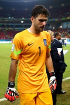 RECIFE, BRAZIL - JUNE 29:  Orestis Karnezis of Greece walks off the pitch after the defeat in the 2014 FIFA World Cup Brazil Round of 16 match between Costa Rica and Greece at Arena Pernambuco on June 29, 2014 in Recife, Brazil.  (Photo by Ryan Pierse - FIFA/FIFA via Getty Images)
