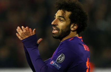 Liverpool forward Mohamed Salah reacts during the Champions League group C soccer match between Red Star and Liverpool at Rajko Mitic stadium in Belgrade, Tuesday, Nov. 6, 2018. (AP Photo/Darko Vojinovic)