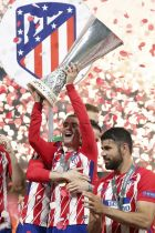 Atletico's Antoine Griezmann holds the trophy after his team win the Europa League Final soccer match between Marseille and Atletico Madrid at the Stade de Lyon in Decines, outside Lyon, France, Wednesday, May 16, 2018. (AP Photo/Thibault Camus)