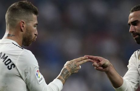 Real Madrid's Sergio Ramos, left, celebrates after scoring a penalty and his team's fourth goal with teammate Dani Carvajal during the Spanish La Liga soccer match between Real Madrid and Leganes at the Santiago Bernabeu stadium in Madrid, Saturday, Sep. 1, 2018. (AP Photo/Andrea Comas)