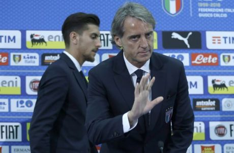 Italy's coach Roberto Mancini arrives on stage with his player Lorenzo Pellegrini before answering questions during a press conference held at the Allianz Riviera stadium in Nice, southern France, on the eve of a friendly soccer match between France and Italy, Thursday, May 31, 2018. (Photo/Claude Paris)