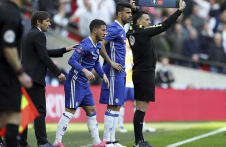 Chelsea's team manager Antonio Conte, 2nd left, talks to Chelsea's Eden Hazard, center, and Diego Costa getting ready to enter the pitch during the second half of the English FA Cup semifinal soccer match between Chelsea and Tottenham Hotspur at Wembley stadium in London, Saturday, April 22, 2017. (AP Photo/Tim Ireland)