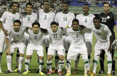 Saudi national soccer team pose for a team photo before their 2014 FIFA World Cup Asia qualifying soccer match against Australia at the Prince Muhammad bin Fahd Stadium in the eastern port city of Dammam, Saudi Arabia, Tuesday, Sept. 6, 2011. Australia won 3-1. (AP Photo/Hassan Ammar)