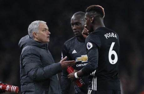 Manchester United coach Jose Mourinho talks with Manchester United's Paul Pogba, right, during the English Premier League soccer match between Arsenal and Manchester United at the Emirates stadium in London, Saturday, Dec. 2, 2017. (AP Photo/Kirsty Wigglesworth)