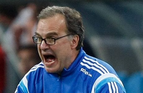 FILE - In this May 10, 2015 file photo, Marseille's coach Marcelo Bielsa, of Argentina, shouts instructions during a League One soccer match between Marseille and Monaco in Marseille, France.  In the latest controversy in his coaching career, Marcelo Bielsa quit as coach of Lazio on Friday, July 8, 2016, just two days after the Italian club announced it signed the former Argentina manager. (AP Photo/Claude Paris, FILE)