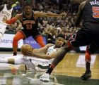 Milwaukee Bucks' Giannis Antetokounmpo looks to pass from the floor against the Chicago Bulls during the second half of an NBA basketball game Tuesday, Dec. 26, 2017, in Milwaukee. (AP Photo/Jeffrey Phelps)